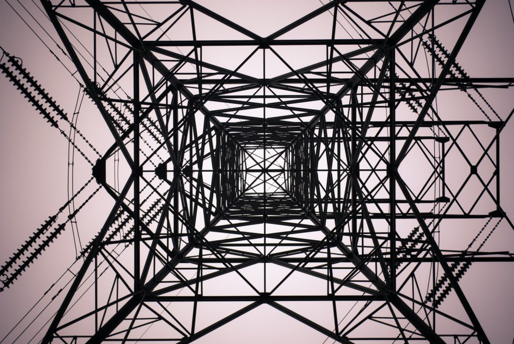 high voltage tower from the bottom perspective