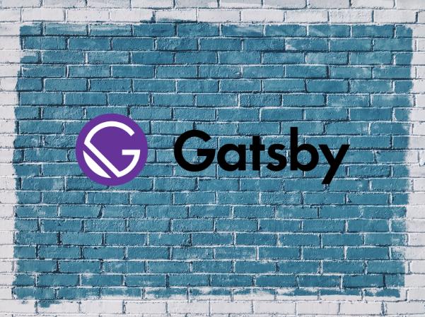 a gatsby sighn on a brick wall