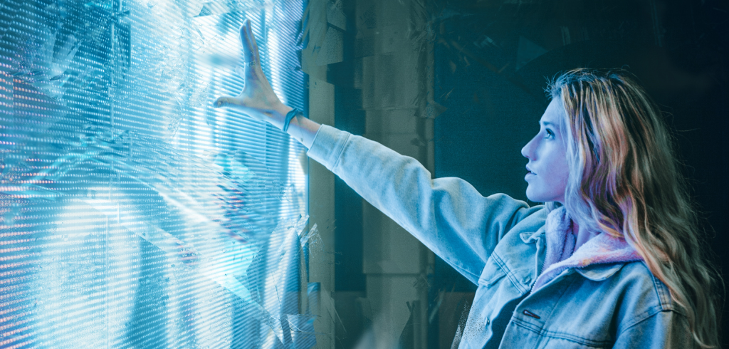 a woman touches interactive futuristic screen