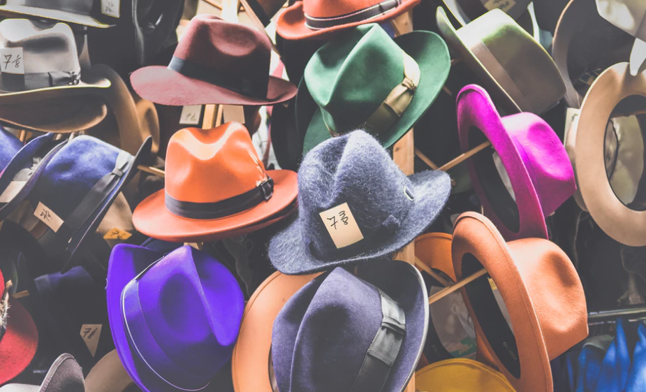 a lot of different color hats on a bargain