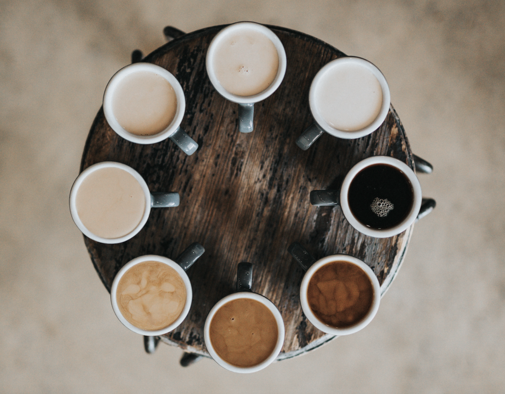 different coffies on a wooden table