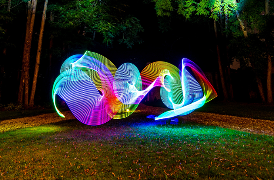 people playing with colorful lights